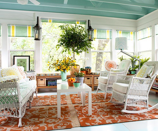 Even sunrooms need windows treatments to protect you durning hot summer days. Although here turquoise ceiling is definitely a focal point.