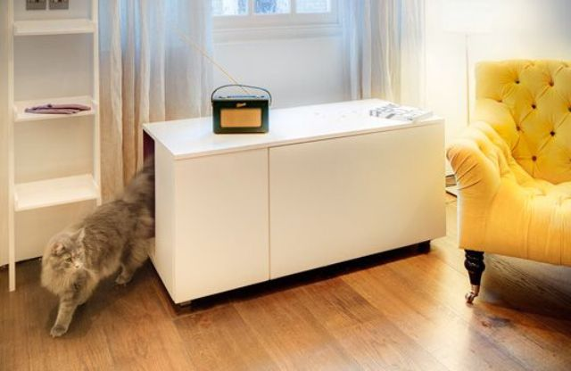 a sleek white cabinet with a cat litter box inside in your living room will keep the cat's privacy