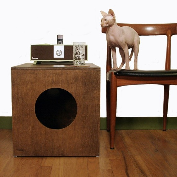 a dark stained box with a round entrance and a cat litter box inside is a stylish solution for a mid century modern space