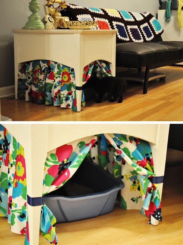 a side table with colorful curtains for some privacy plus a cat litter box inside is a simple idea for a modern space