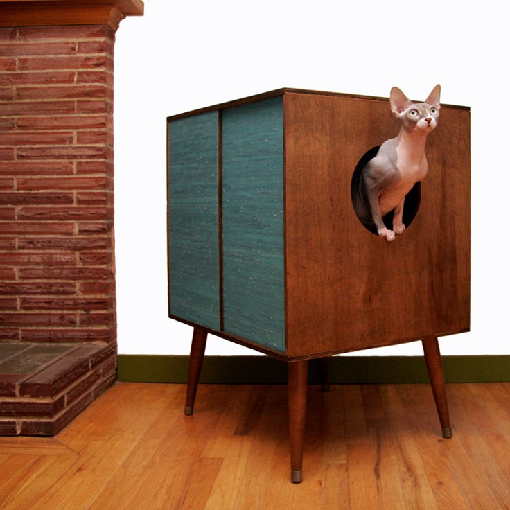 a dark stained box on legs with a cat litter box and an entrance will perfectly fit a mid century modern space