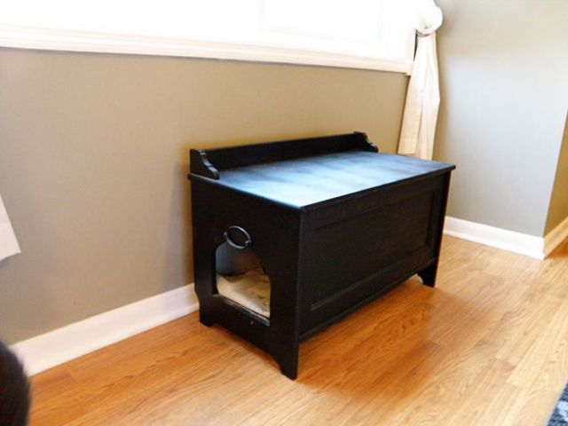a small black bench with a cat litter box inside can double as a cat bed and can be placed in your entryway
