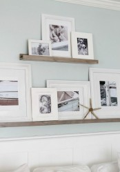 wooden ledges of various sizes with black and white artworks in frames are lovely for creating your own gallery wall in any space