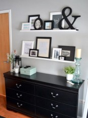 white ledges with artworks, ampersands, photos and other stuff are great to create an elegant gallery wall