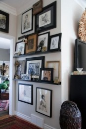 an awkward nook used to advantage with black ledges and lots of artworks and figurines is a fresh idea to rock