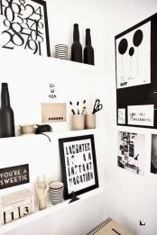 a small nook made useful with white ledges, with black and white artworks, photos, figurines, decor looks cool