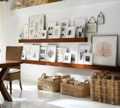 a farmhouse space with thick wooden ledges that display artworks and photos – this is a cool idea that perfectly matches the decor of the space