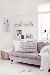 an airy Scandinavian space with ledges that are used for displaying art, vases, monograms, antlers and other stuff