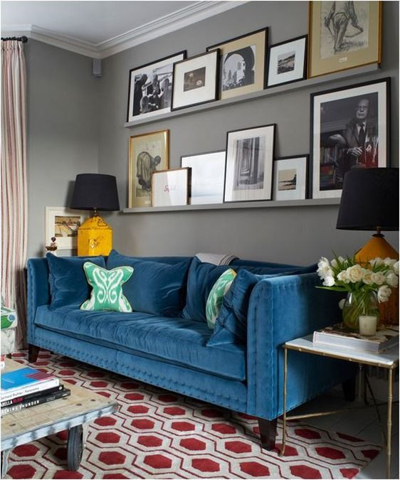 ledges that match the walls in color create a seamless gallery wall that is great for any space