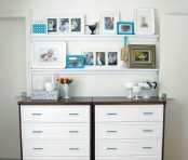 white ledges over the dressers create a whole wall gallery with various artworks and photos and it brings coziness here