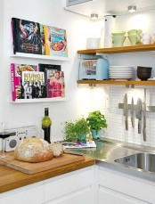 attach some ledges in your kitchen to display your cooking books and have them always at hand
