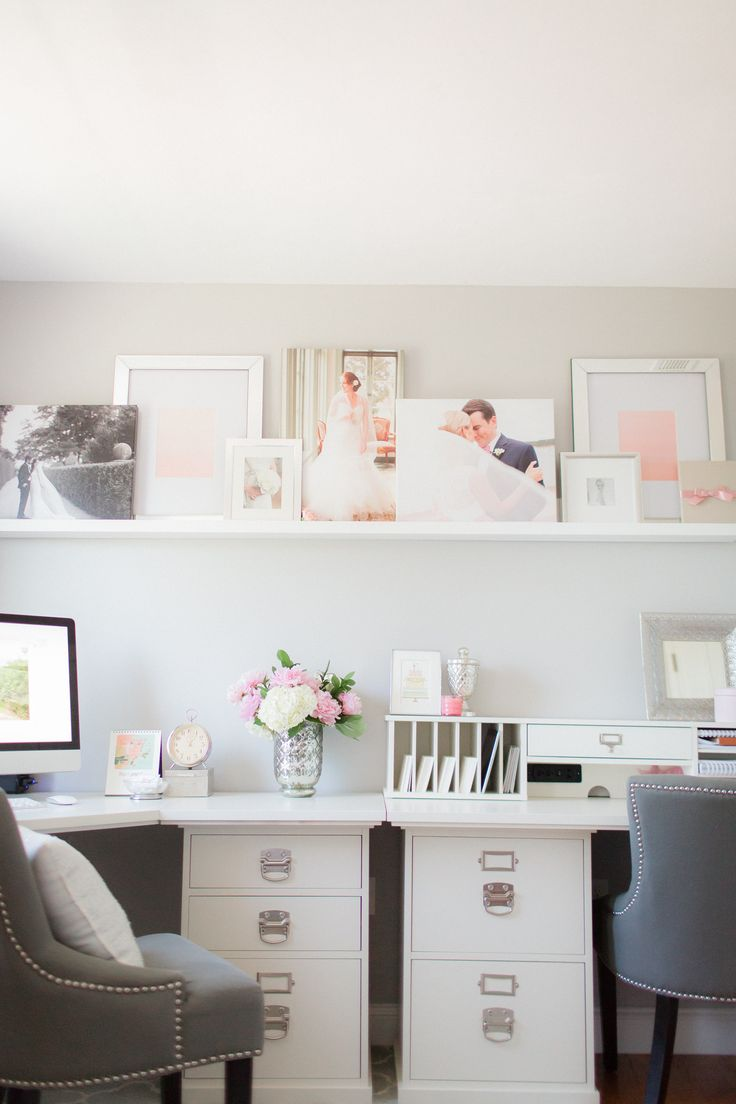 an elegant shared home office with a ledge taking the whole wall over the desks to display artworks and photos is a nice idea to cozy up your working room