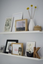 ledges with artworks, monograms, photos, billy balls and mini baskets are a nice way to create your own gallery wall with various stuff