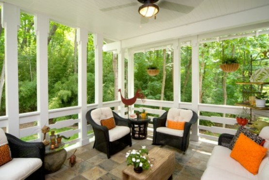 a modern terrace or porch with simple wicker furniture, bright pillows and blankets, potted blooms and greenery to rest here