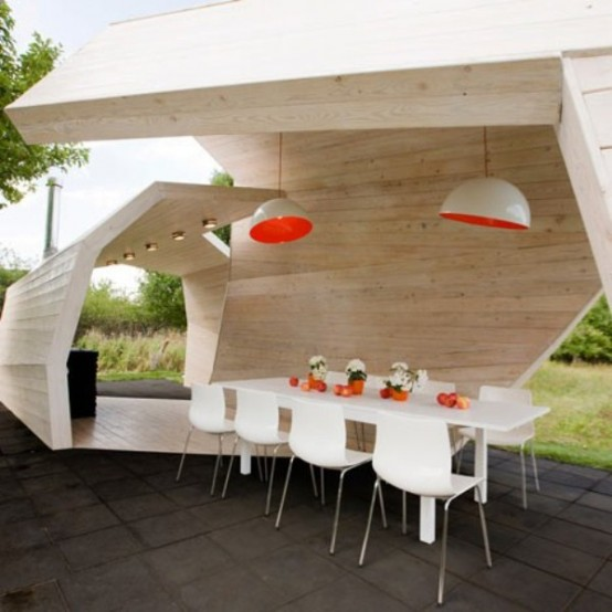 an ultra-modern dining space under a wooden roof in a neutral color, with pendant lamps and with white dining set