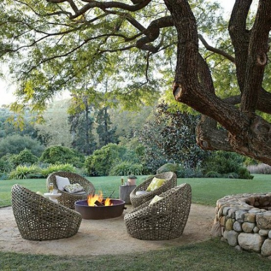 a modern outdoor space with a fire pit, wicker papasan chairs is an ideal place to spend some time and enjoy fresh air