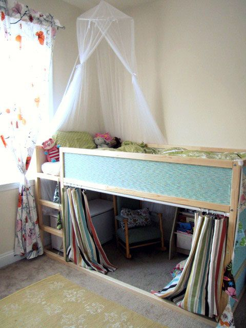 Luxury IKEA Kura bed hack with a wallpaper and a canopy