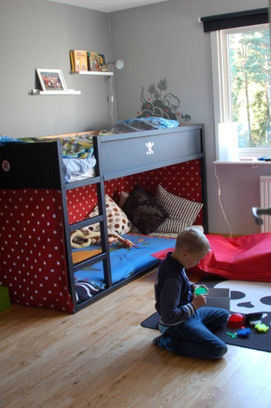 All black IKEA Kura bed for a boys room