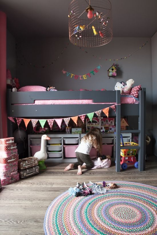 All black IKEA Kura bed for a girls room