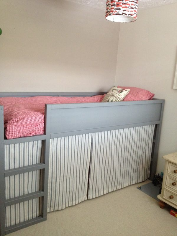 Light gray IKEA Kura bed with a secret