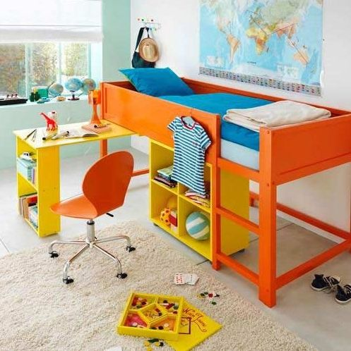 Bright orange IKEA Kura bed hack with a desk