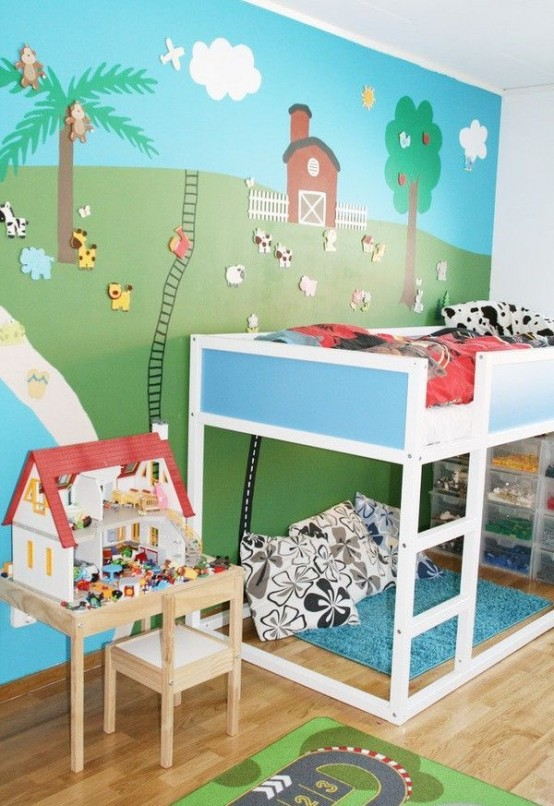 Blue-white Ikea Kura bed in a cute kids room