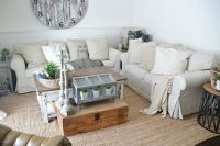 couple of off-white IKEA  sofas for a rustic living room
