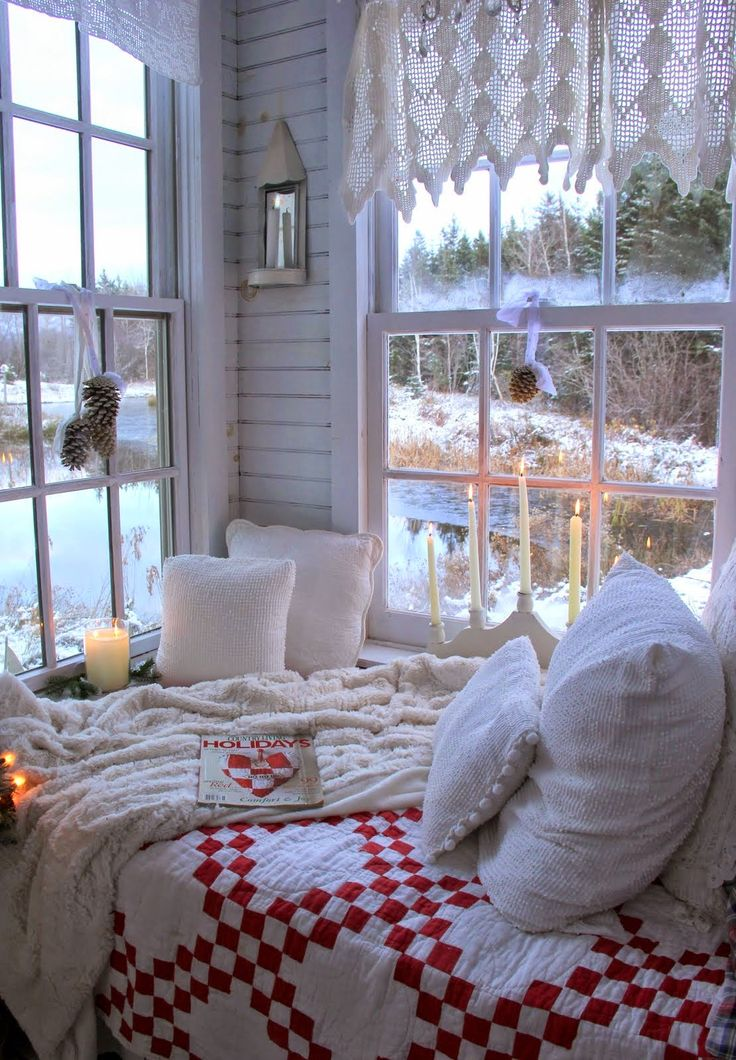 white crochet curtains, pinecone posies, knit bedding and plaid textiles plus candles for a winter like space