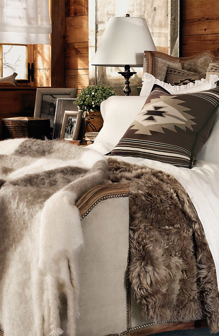 lots of faux fur and knit pillows will cozy up your bedroom and make it winter ready at once