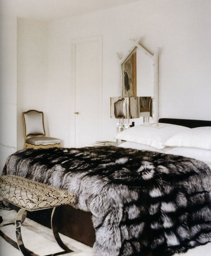 a lush faux fur blanket will add a refined touch and coziness to your bedroom and make it feel like winter