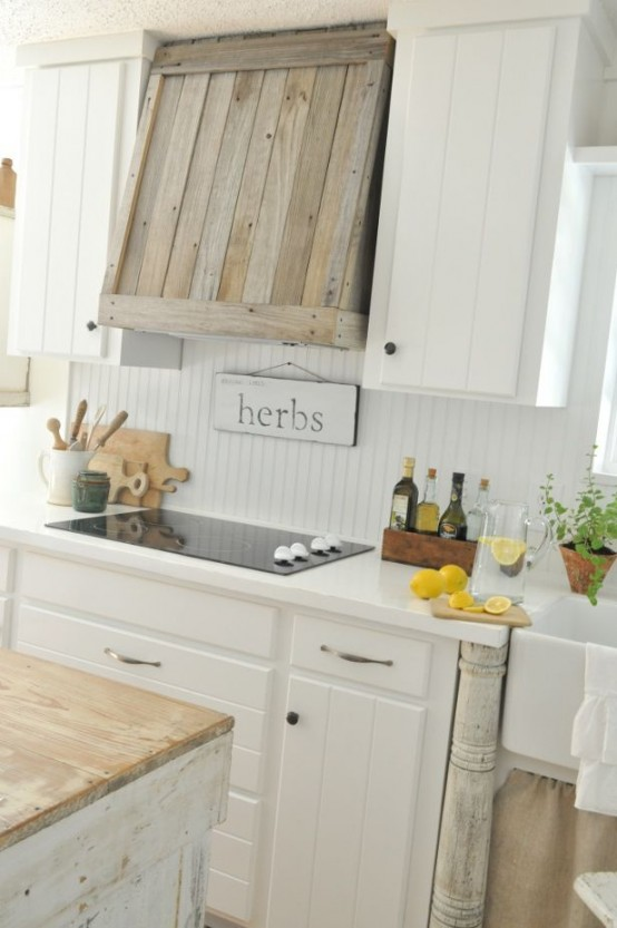 Building a cover for your modern cooking hood from wood scraps would totally work for farmhouse kitchen decor.