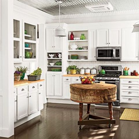 Farmhouse decor looks well mixed with contemporary stainless steel  appliances.