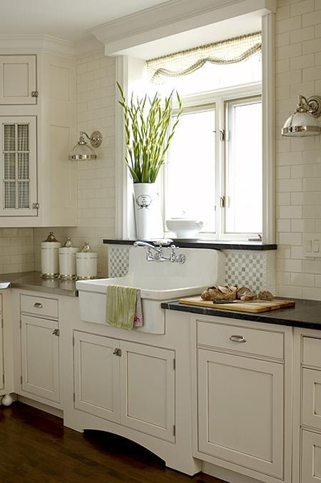 Placing  a sink near a window is a great way to highlight its design.