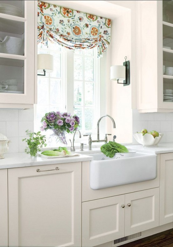 The idea of surrounding things you want to highlight with two wall-mount light fixtures works well with farmhouse sinks.