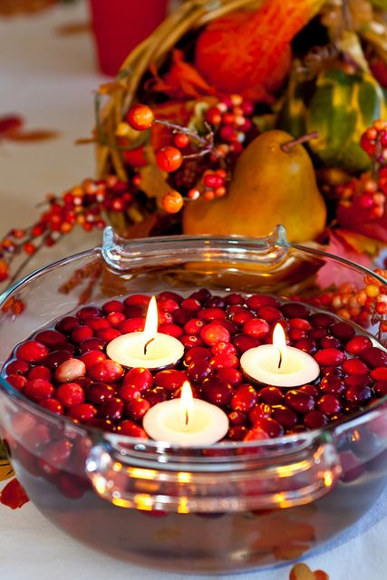 a bowl with cranberries and floating candles is an easy and very cool rustic centerpiece for the fall
