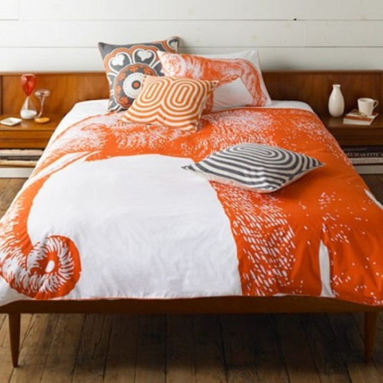 bright orange, grey and stained wood for a bold fall-inspired bedroom with plenty of pattern