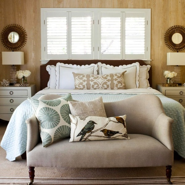 neutrals, touches of green and blue and chocolate brown make the bedroom fall like yet rather calming and not bold