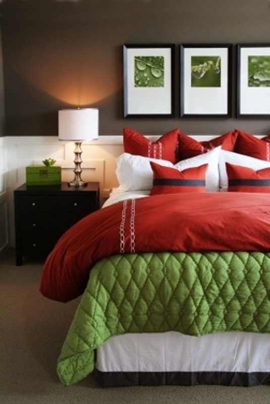 a bright jewel-toned bedroom with bold red and green and some very dark brown for a bold look
