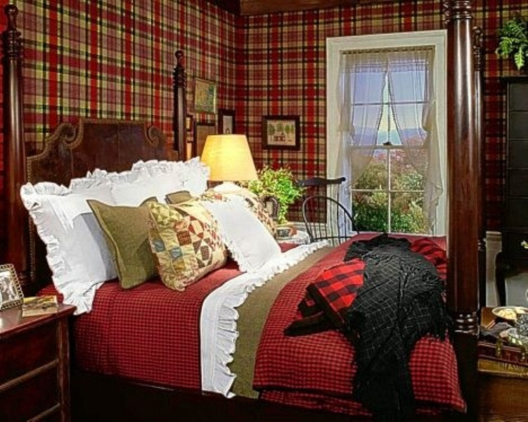 a bright fall bedroom done in burgundy, red and greens plus some bright white touches and plaid