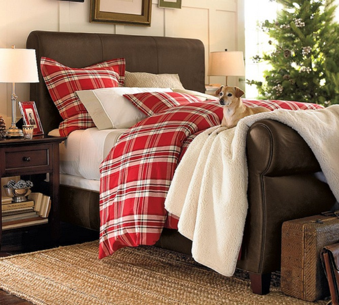 a cozy modern bedroom done with beige, chocolate brown, touches of red plaid and greenery