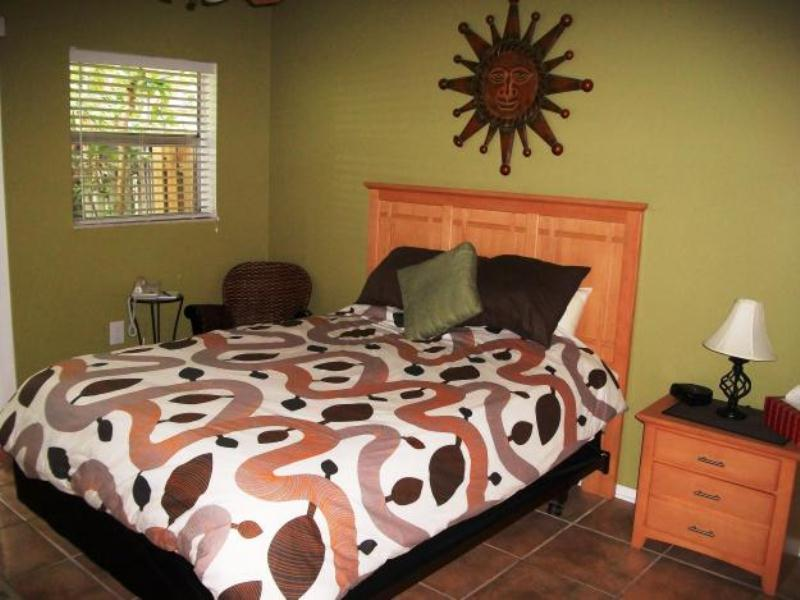 a colorful fall bedroom done in chocolate brown, green, rust and burgundy plus some pattern