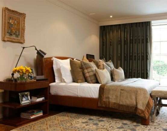 a fall bedroom done in neutrals, rust, greens and brown shades plus some touches of vintage elegance in decor