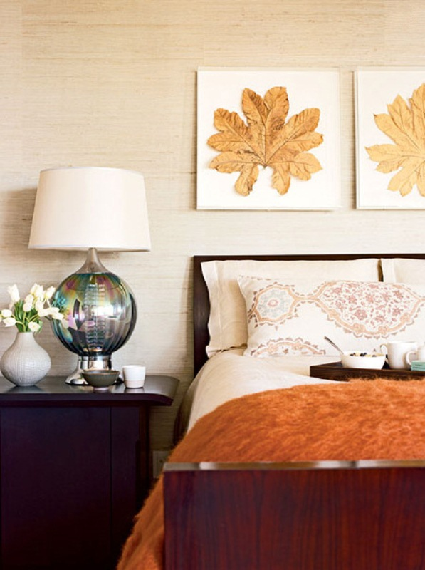 a fall bedroom with burgundy and purple touches, rust and orange decor and some touches of gold that bring a fall feel