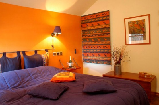 a bright fall bedroom done in orange, purple, greens and neutrals plus some fall patterns
