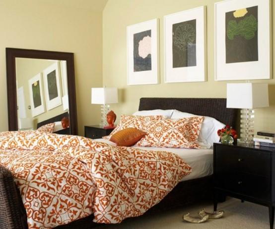 black, chocolate brown and touches of orange make this bedroom really fall-like