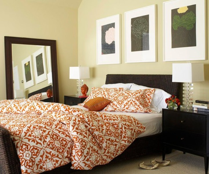 black, chocolate brown and touches of orange make this bedroom really fall like