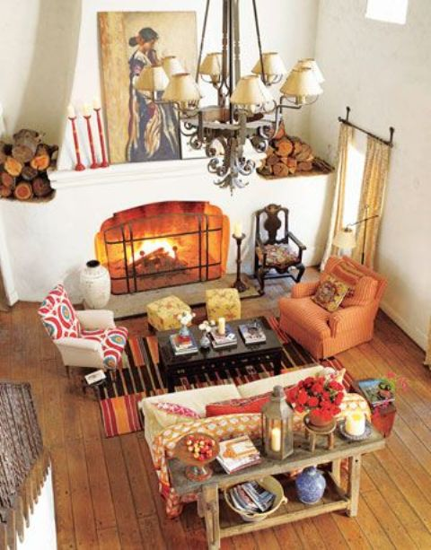 a bold printed rug, a rust colored chair and red textiles here and there make your space fall like