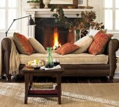 bright rust-colored printed pillows add a fall feel to the space making it cooler