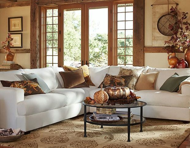 fall colored pillows and a rug add a fall feeling to the living room and make it seasonal easily