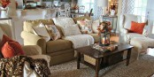 bright orange pillows, printed pillows, a neutral rug for an easy fall touch